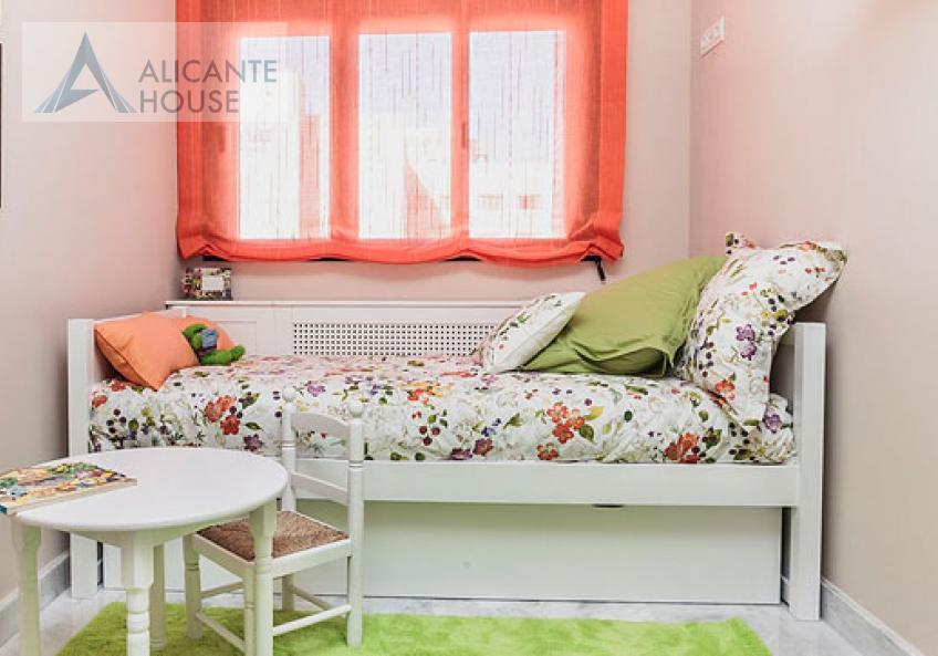 Children's bedroom is cozy and bright