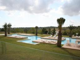 Yellow complex and swimming pool on site